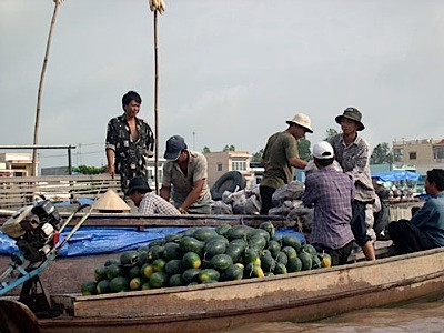 Vegetable sellers on the Mekong river